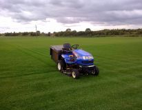 Kirton Lindsey, Lincolnshire. New sports field ( 4 acres) only 8 weeks from the seeding date. Our machine is doing the second cut & collect as part of the initial maintenance package we provided.
