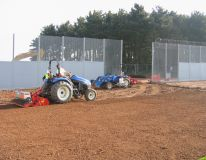 HMP Featherstone Wolverhampton. Preparing the surrounds of the new rugby pitch ready for grass seeding.