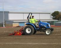 Mark Hall school and sports colledge in Essex. Preparing the infield athletics area ready for grass seeding following earth levelling & drainage installation.