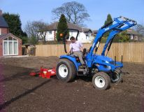 Compact tractor and 1m stone burier preparing the back lawn area for a new build home at North Thoresby near Louth.