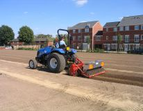 Dashwood Primary School in Banbury Oxfordshire. A new build school, our compact tractor and machine and preparing the playing field area for seeding following drainage installation.