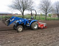 New Holland compact and 1.3m RotaDairon preparing a primary school playing field at Worksop after the field was levelled by earth moving machinery.